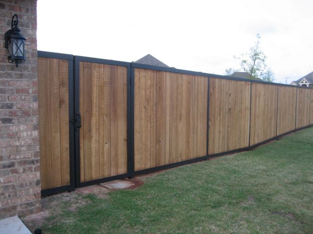 a nice blend of wood and metal fencing